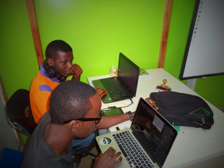 two men using laptop computes