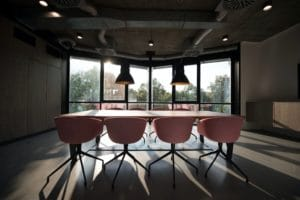 pink dining table with four chairs inside room
