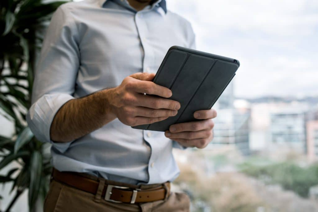 person holding black smart cover during daytime