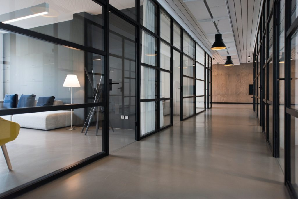 hallway between glass-panel doors