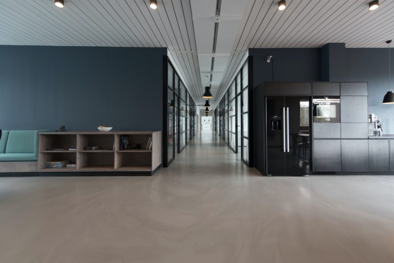 architectural photography of black and brown hallway