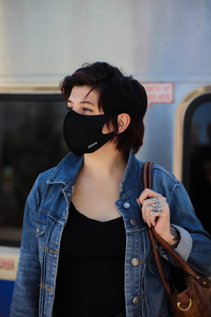 woman in blue denim jacket wearing black sunglasses