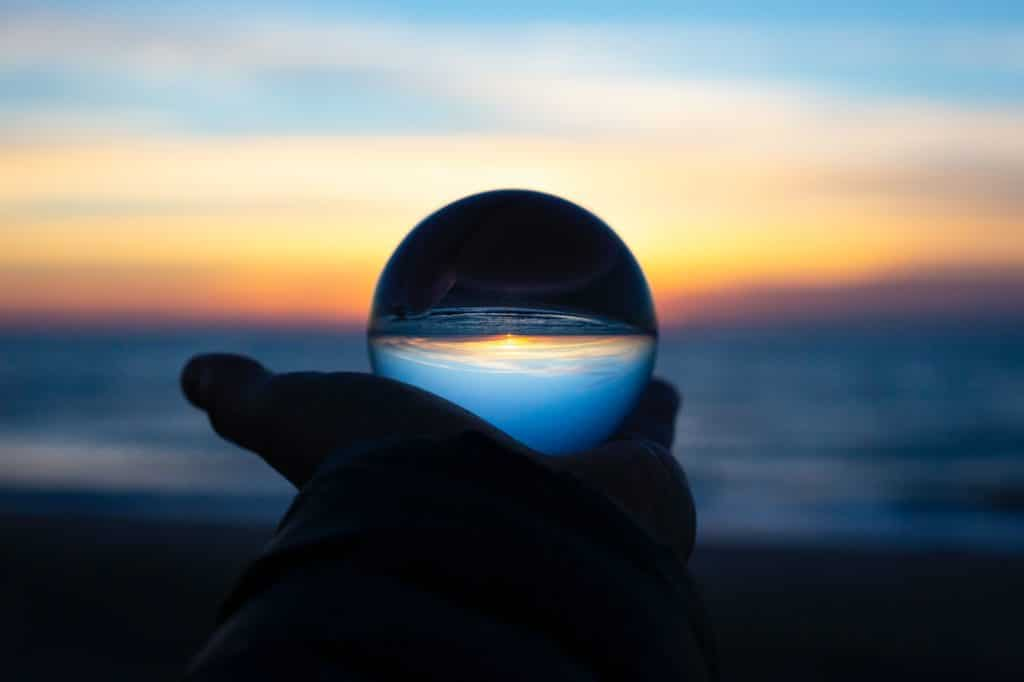 person holding clear glass glass